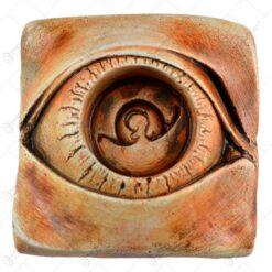 Suport pentru lumanare in forma de ochi realizata din ipsos