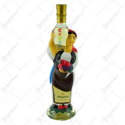 Sticla de vin in forma de femeie. imbracata in port popular romanesc - Muscat Carling