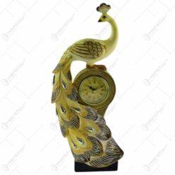 Figurina realizata din rasina in forma de paun cu ceas