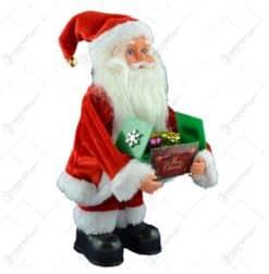 """Mos Craciun muzical cu cutie de cadouri """"Merry Christmas"""" 26 CM"""