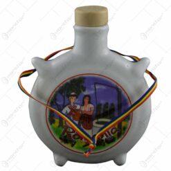 Plosca din ceramica in forma rotunda. fiind imprimata cu tematica Dracula