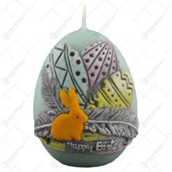 """Lumanare de Paste in forma de ou decorata cu oua colorate si inscriptia """"Happy Easter"""""""